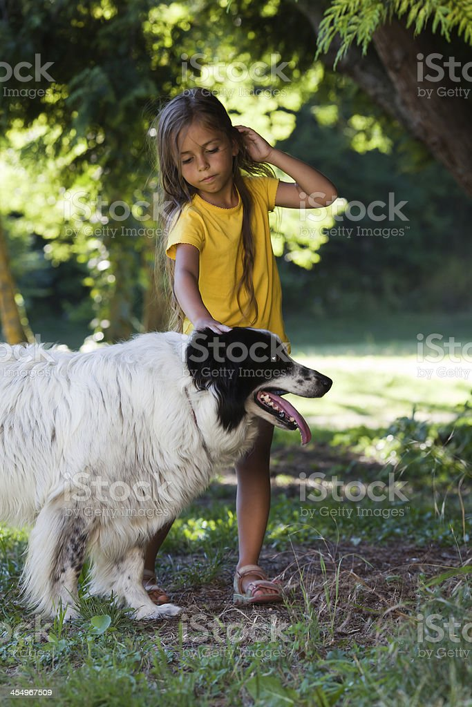 Little girl with dog royalty-free stock photo