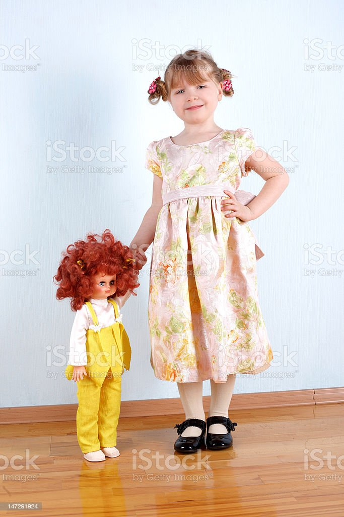 little girl with doll royalty-free stock photo