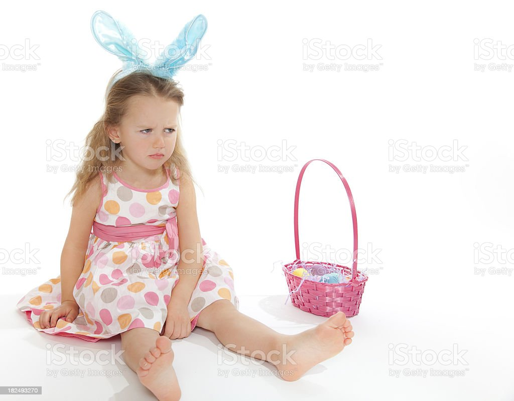 Little girl with Easter basket and bunny ears royalty-free stock photo