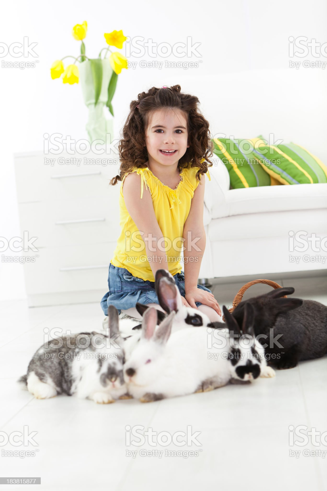 Little girl with Easter bunnies royalty-free stock photo