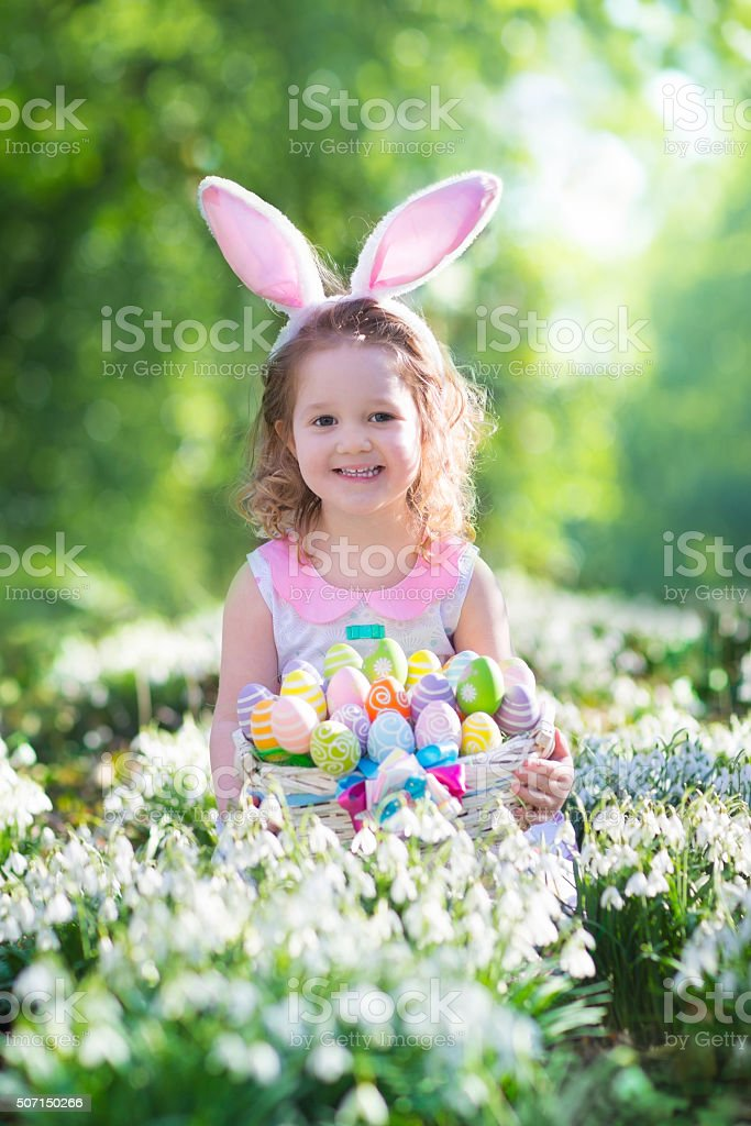 Little girl with Easter bunny ears stock photo