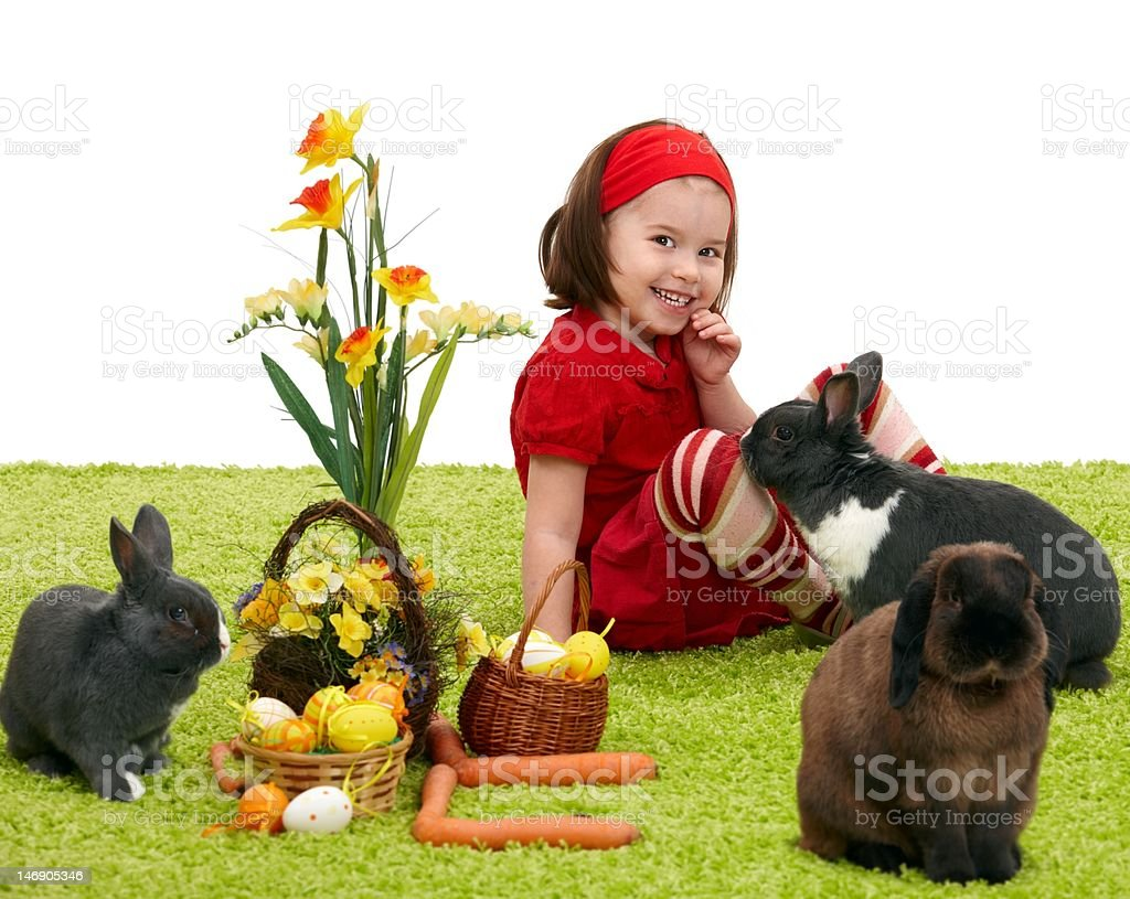Little girl with Easter bunny stock photo