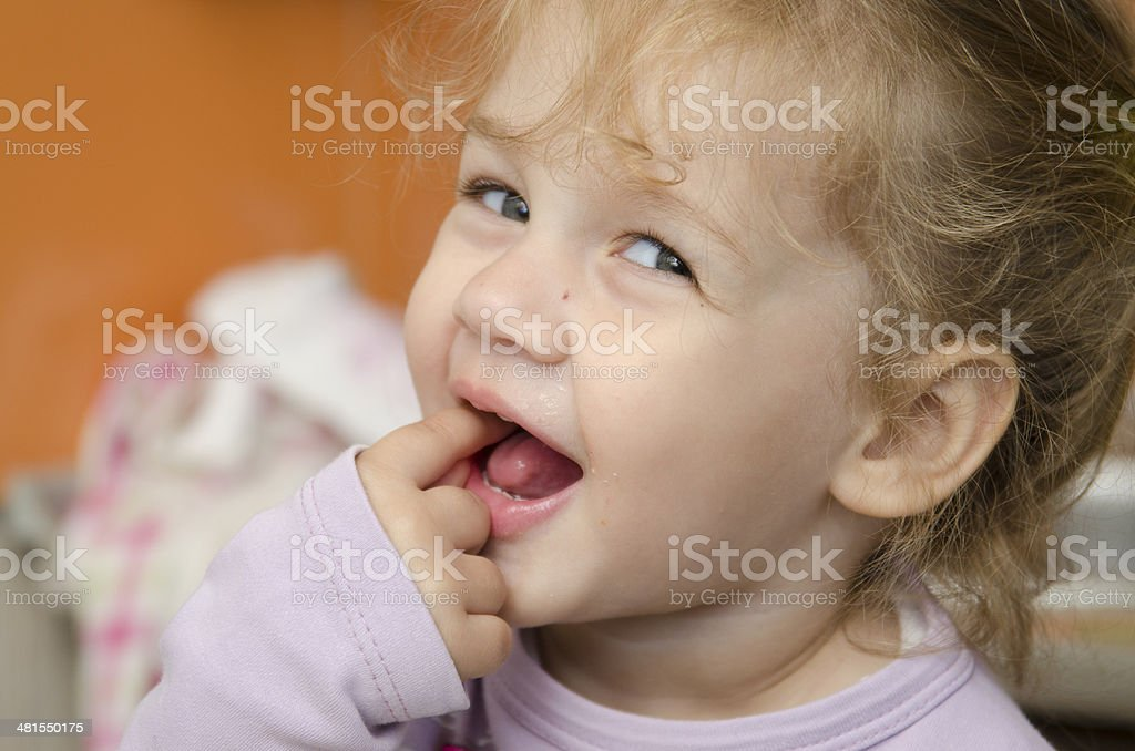 little girl with enthusiasm and eats roll pleasure stock photo