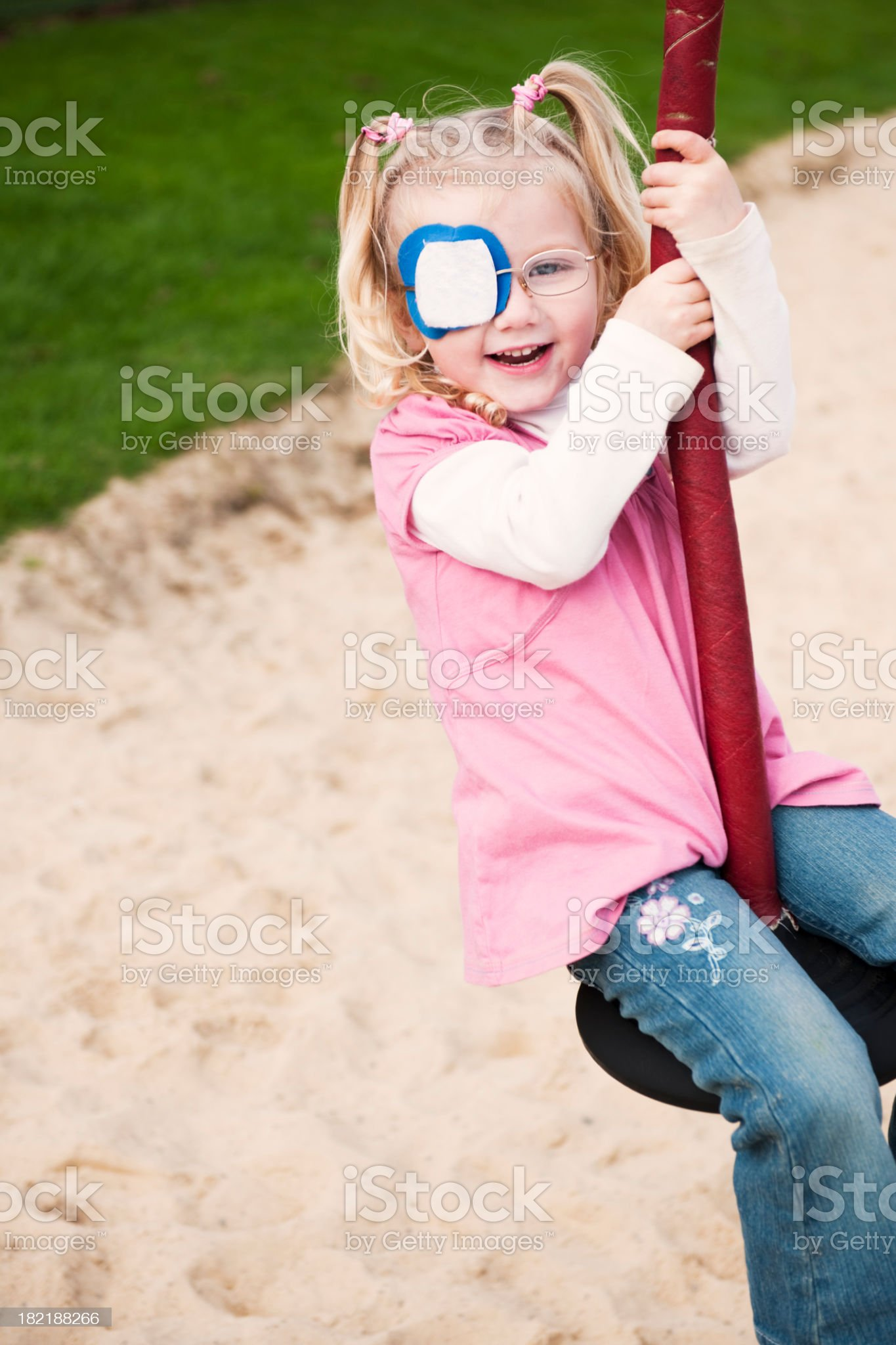 little girl with eye patch having fun royalty-free stock photo