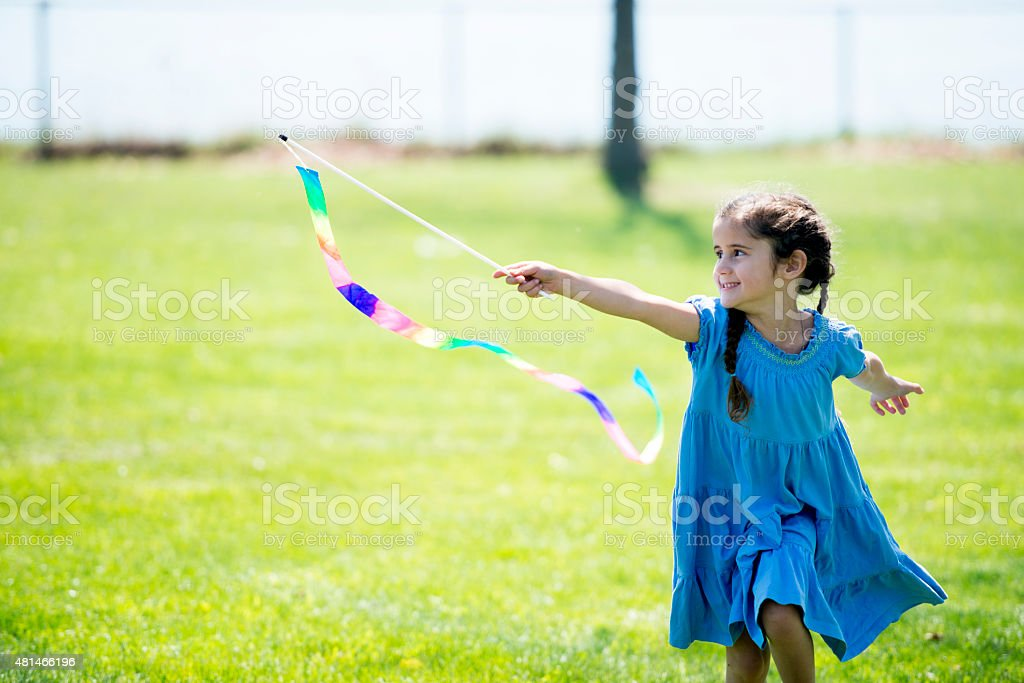 Little Girl with Flag at Park stock photo