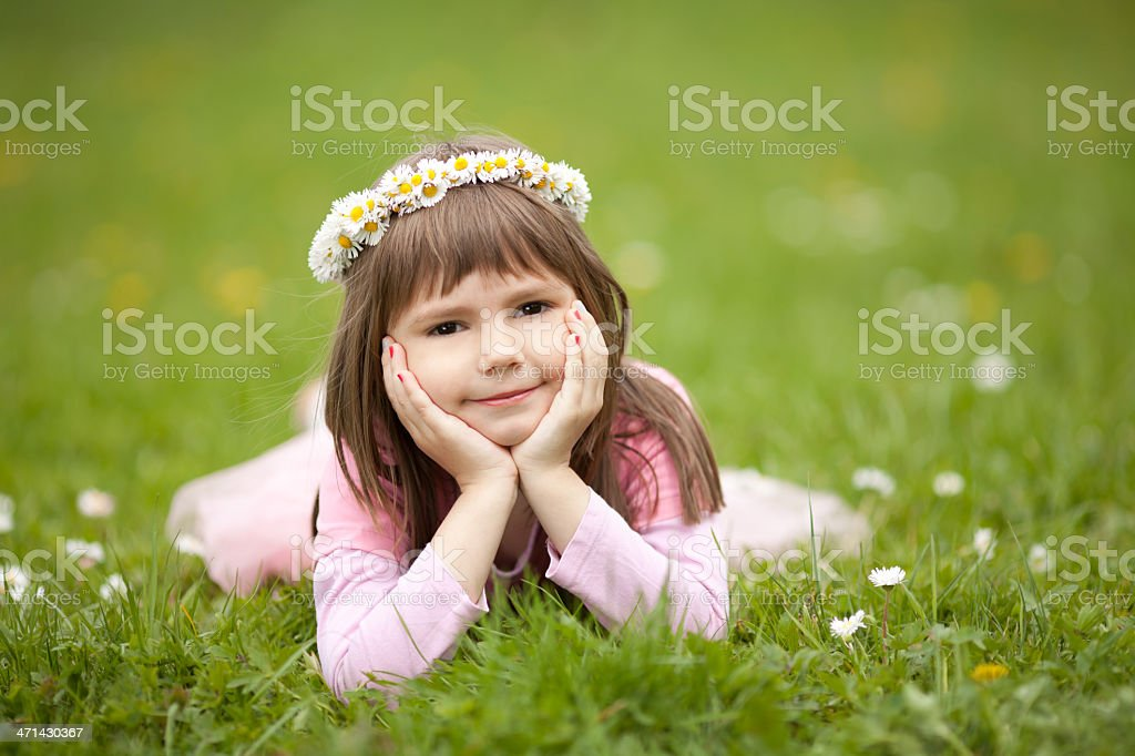 Little girl with flower wreath on her head royalty-free stock photo