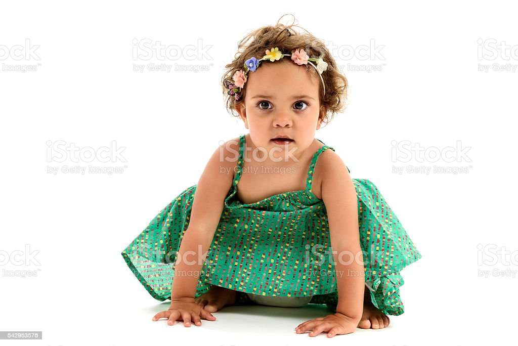 Little mulatto girl with flowers in hair. stock photo