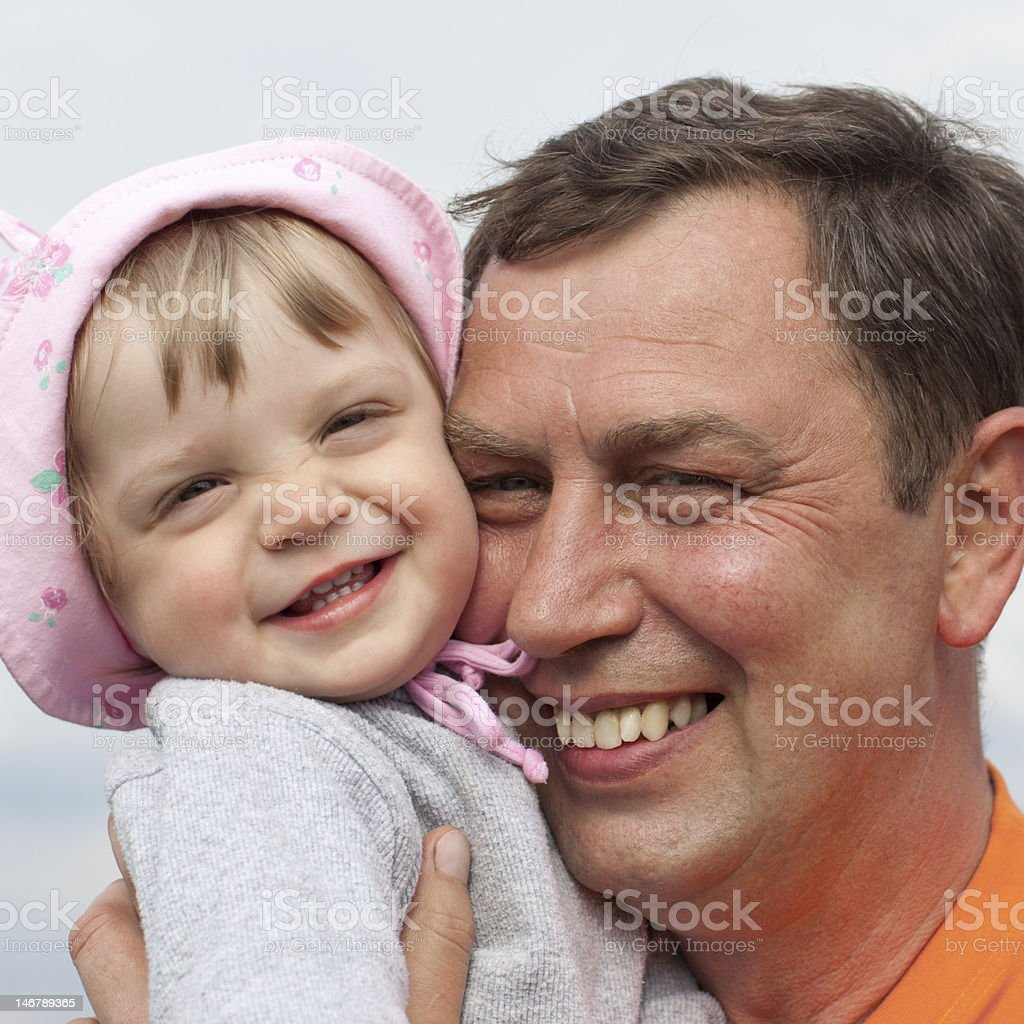 Little girl with grandfather royalty-free stock photo
