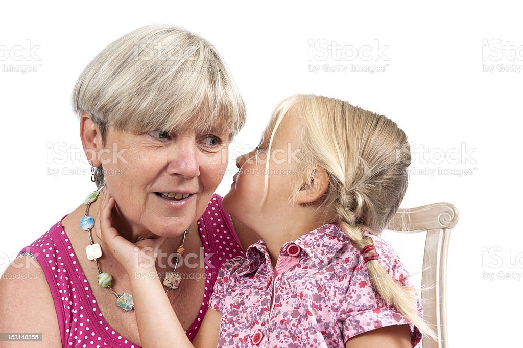 little girl with grandmother on white royalty-free stock photo