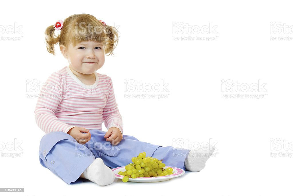 Little girl with grapes royalty-free stock photo