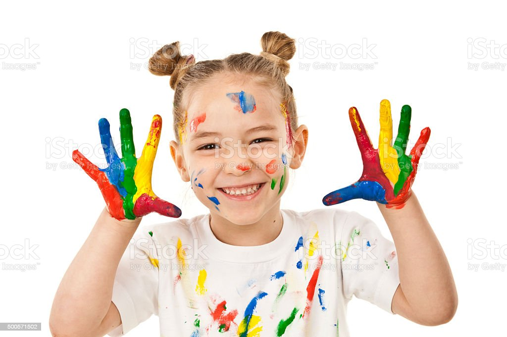 Little girl with hands and face covered with paint stock photo