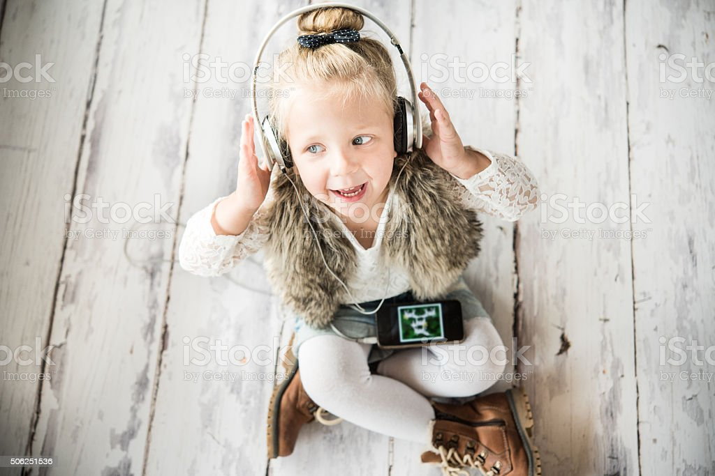 Little girl with headphones stock photo