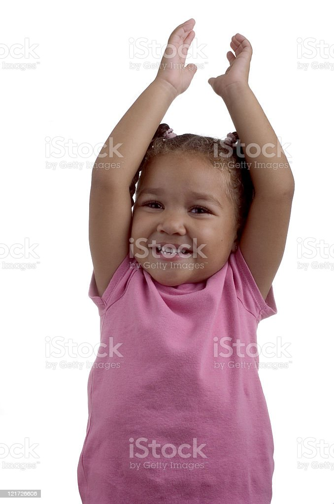 Little Girl with her Arms Raised on White Background stock photo