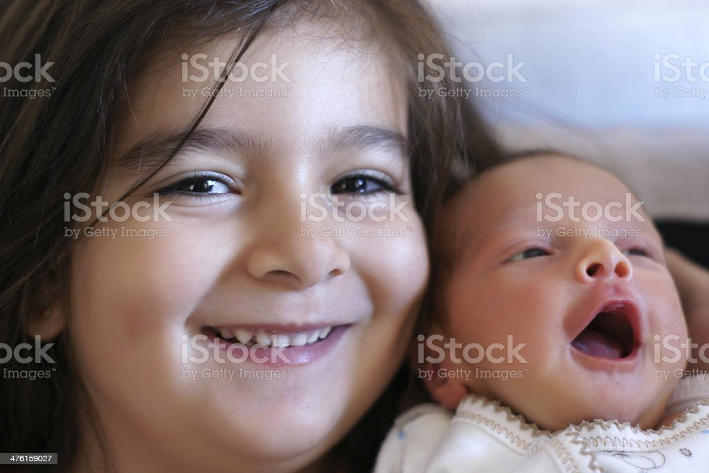 little girl with her brother royalty-free stock photo