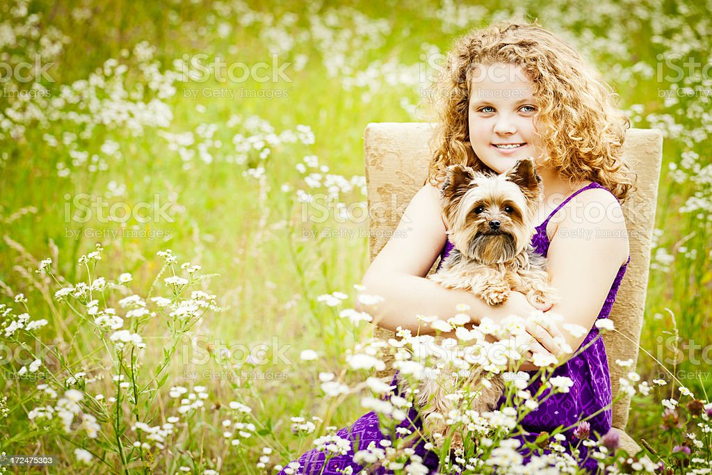 Little Girl with Her Dog in Field of Wildflowers royalty-free stock photo
