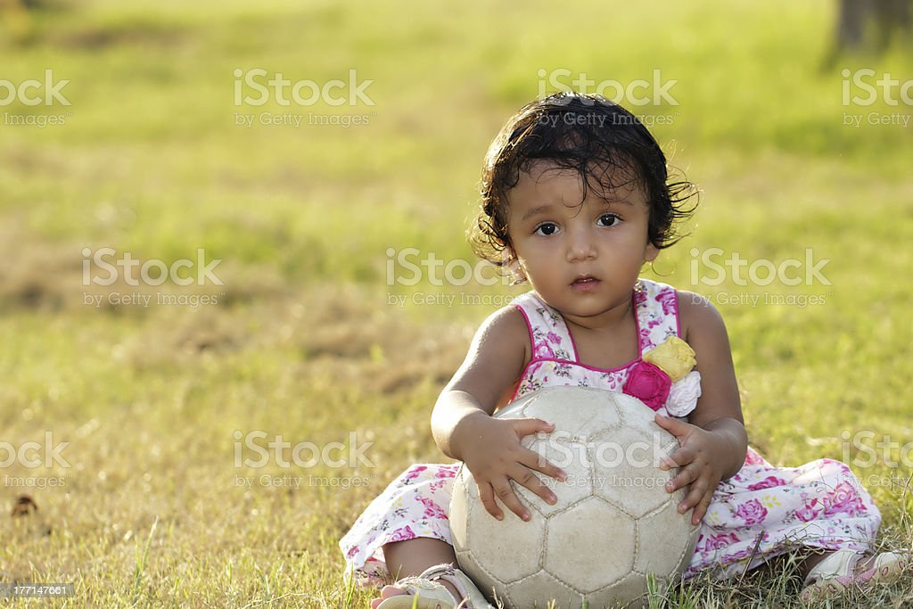 little girl with her football royalty-free stock photo