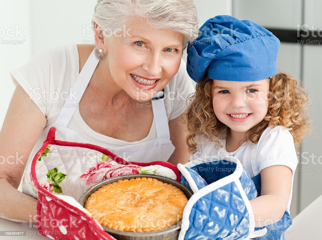 Little girl with her grandmother looking at the camera royalty-free stock photo
