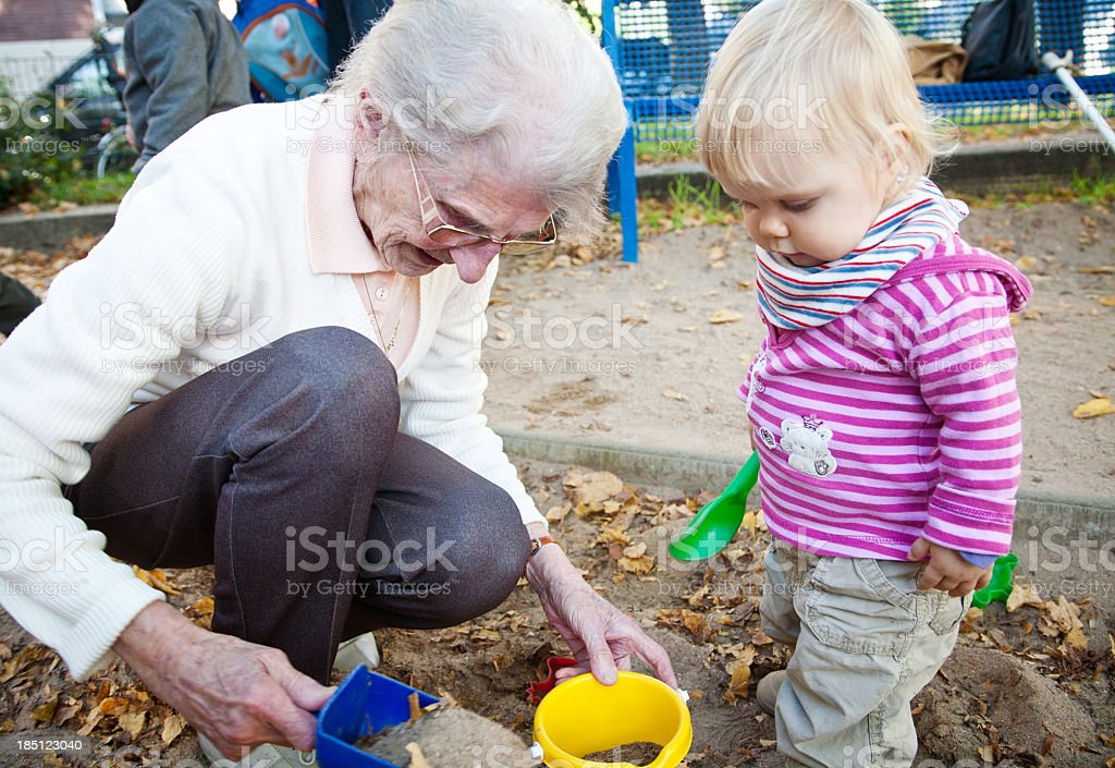 little girl with her great-grandmother stock photo