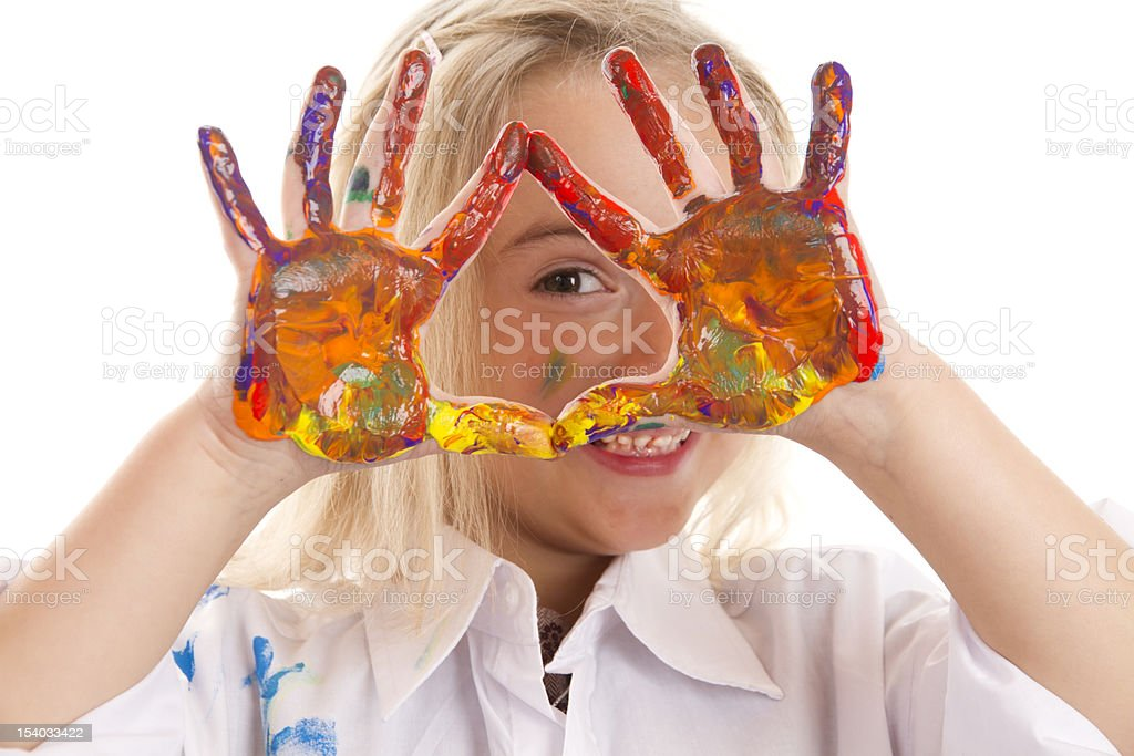 Little girl with her painted hands up stock photo