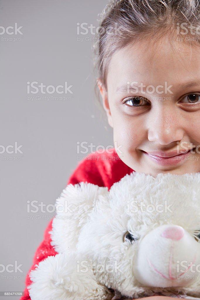 little girl with her teddy bear stock photo