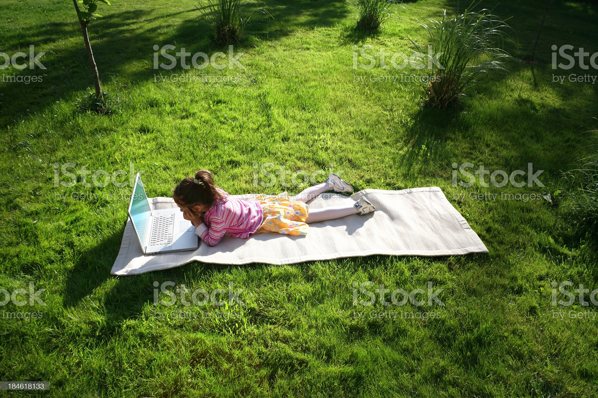 little girl with laptop royalty-free stock photo