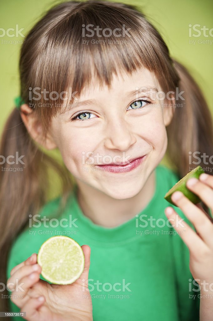 Little girl with lime stock photo