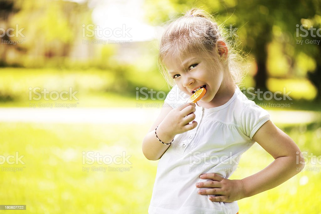 Little Girl with Lollipop royalty-free stock photo