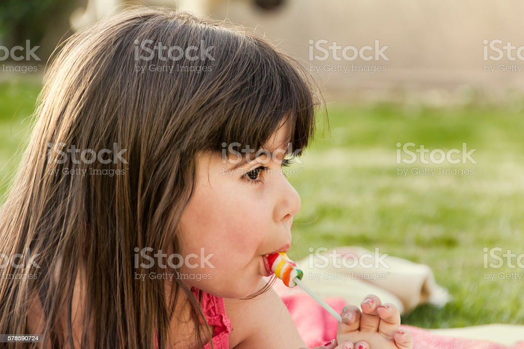 Little girl with lollipop stock photo
