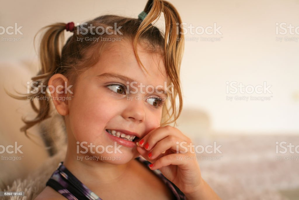 Little girl with loose tooth. stock photo