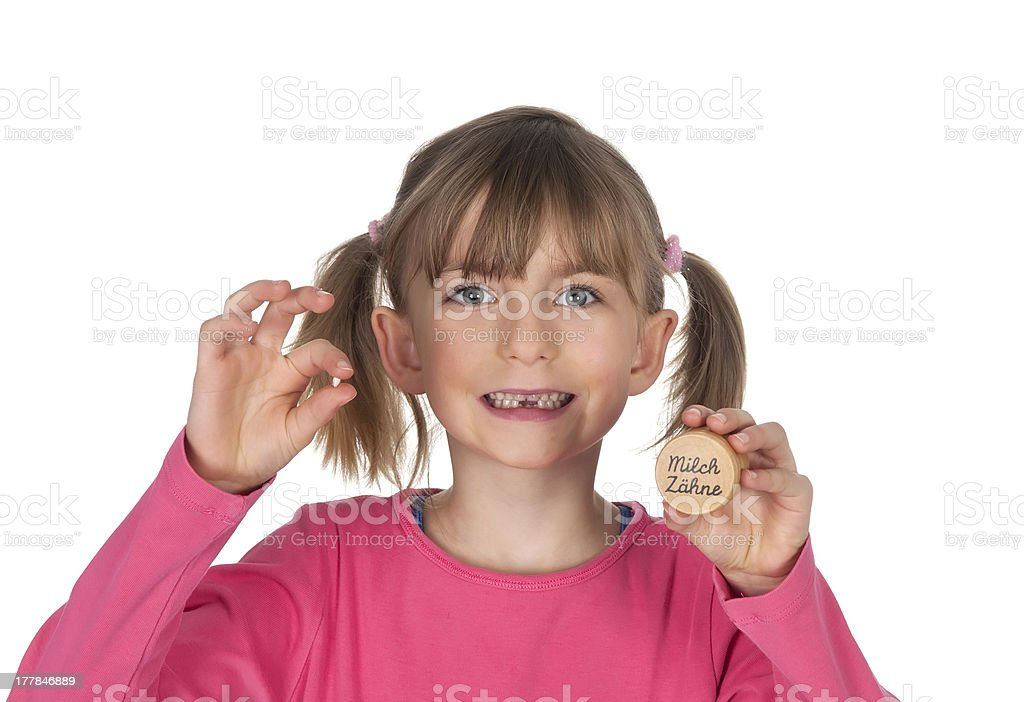 little girl with lost milk tooth stock photo