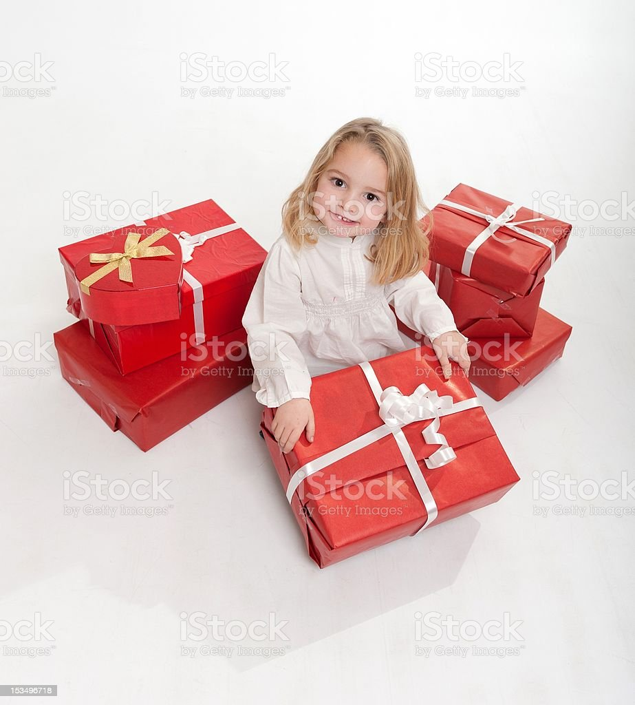 Little girl with lots of presents stock photo