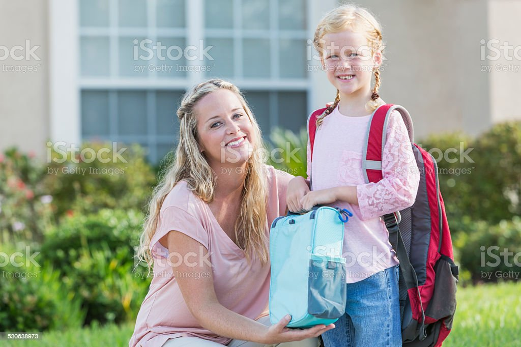 Little girl with mom ready for school stock photo