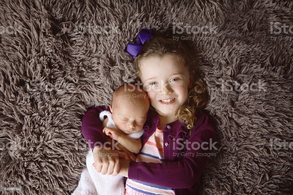 Little Girl with Newborn Brother stock photo