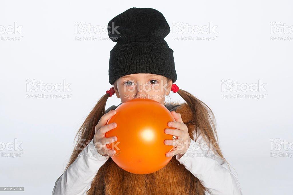 Little girl with orange balloon stock photo