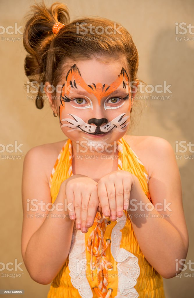 Little girl with paint in the form of a squirrel stock photo
