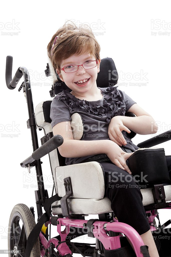 Little Girl with Physical Disability in Wheelchair stock photo