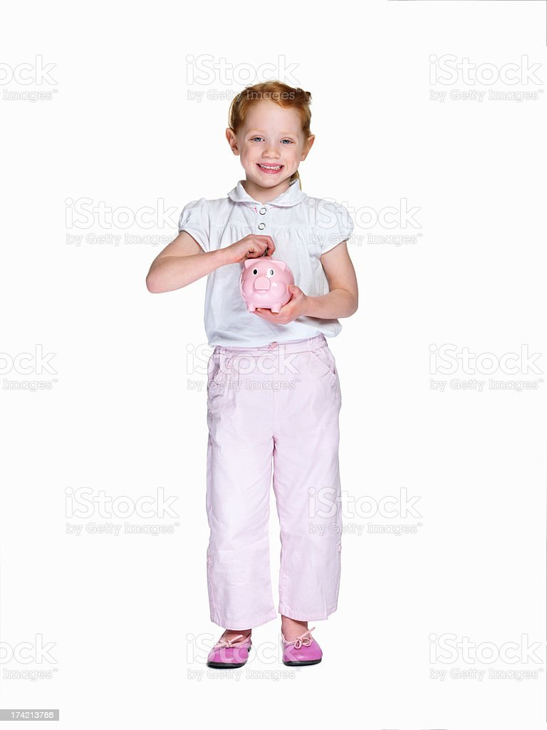Little girl with piggybank isolated against white stock photo