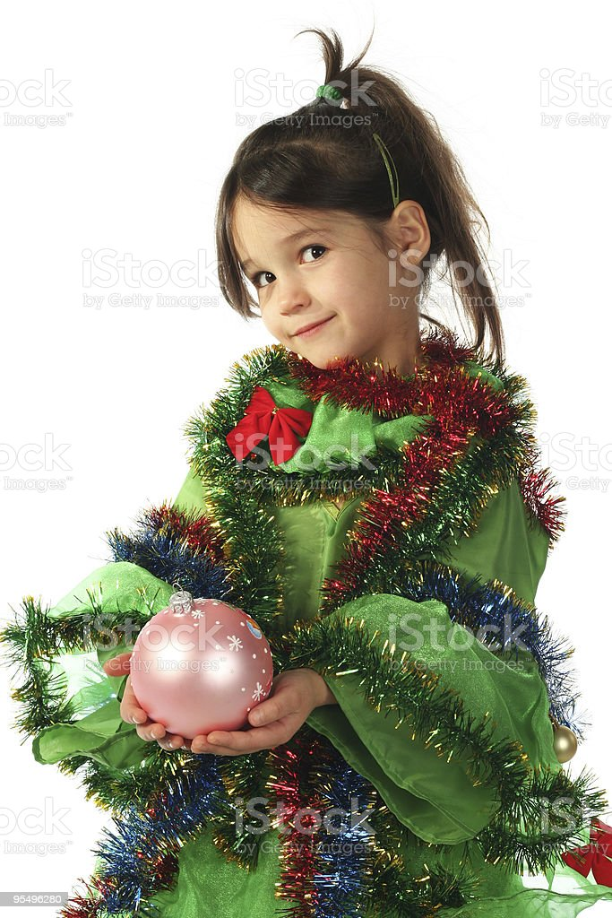Little girl with pink Christmas decoration stock photo