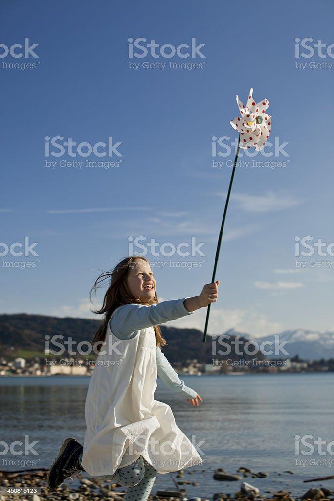 Little girl with pinwheel stock photo