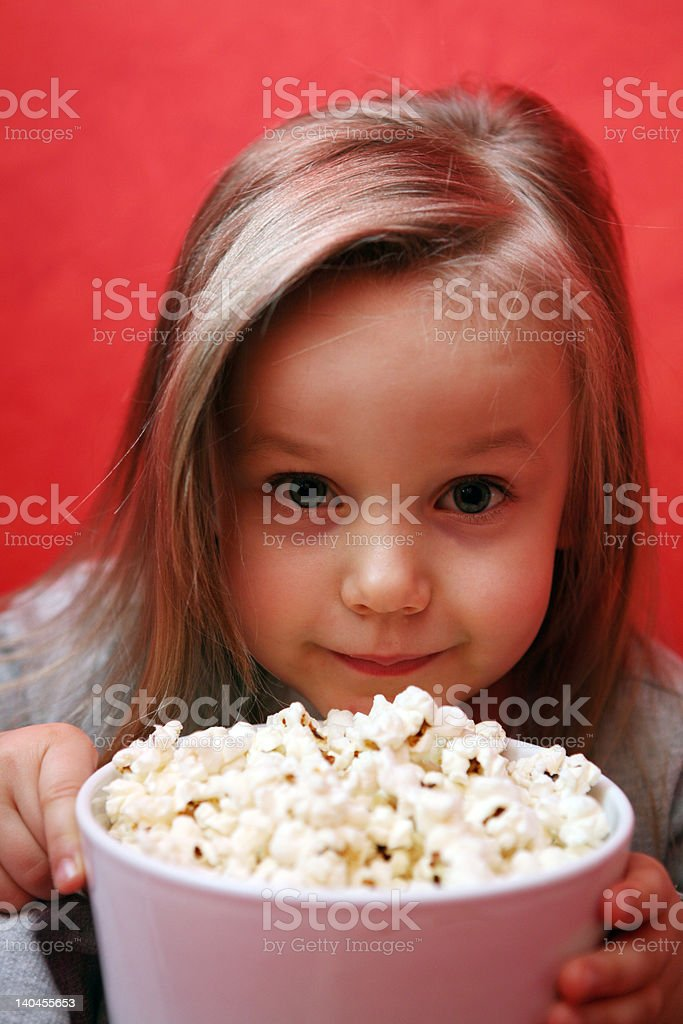 Little girl with popcorn royalty-free stock photo