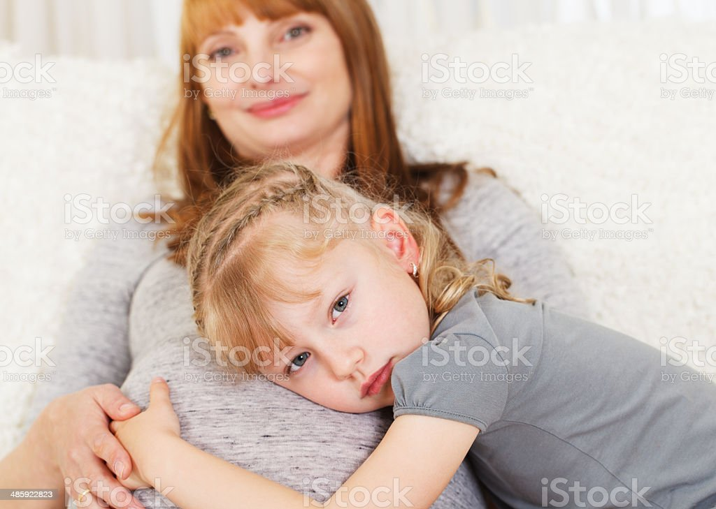 Little girl with pregnant mother stock photo