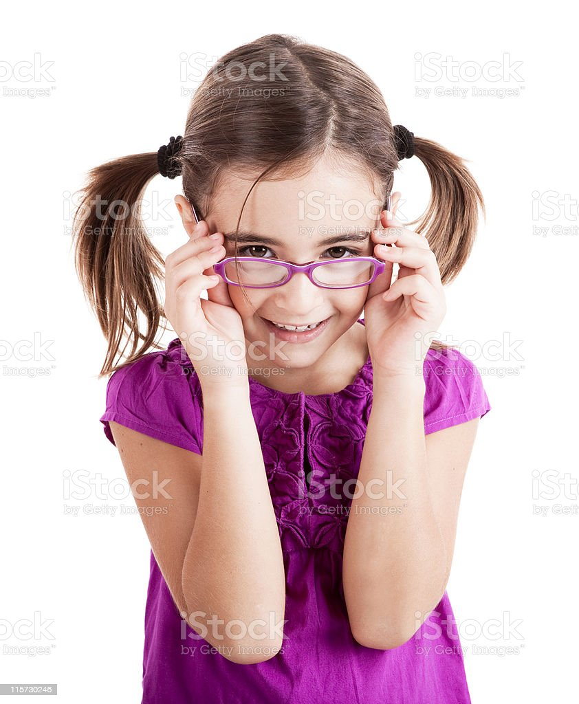 A little girl with purple glasses matching her shirt royalty-free stock photo