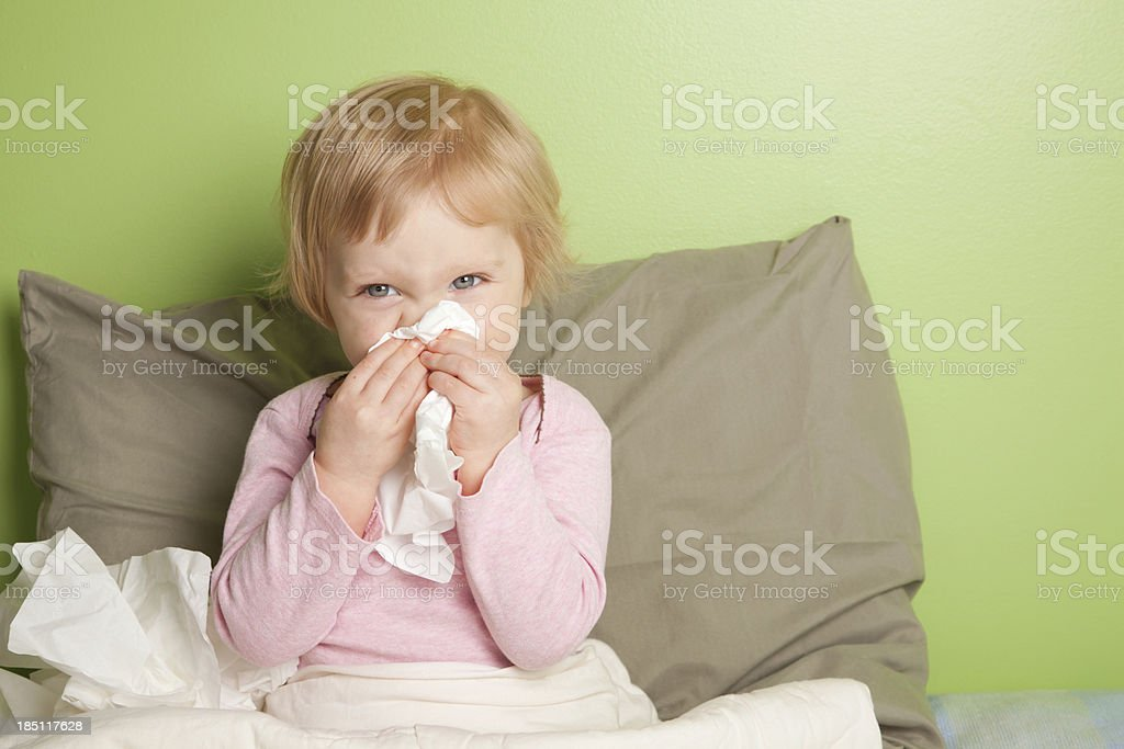 Little girl with runny nose stock photo