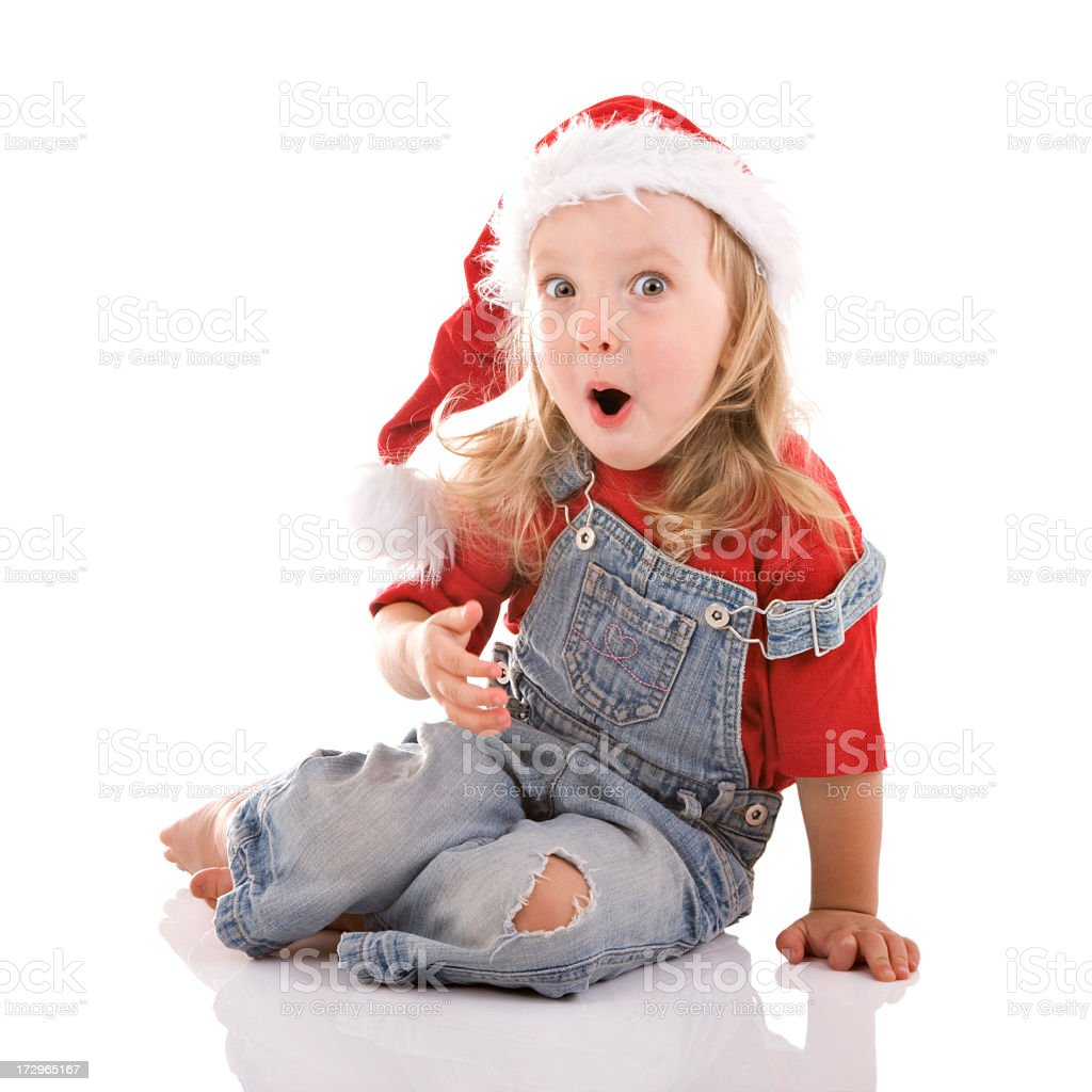 Little girl with Santa hat and a surprised look on her face royalty-free stock photo
