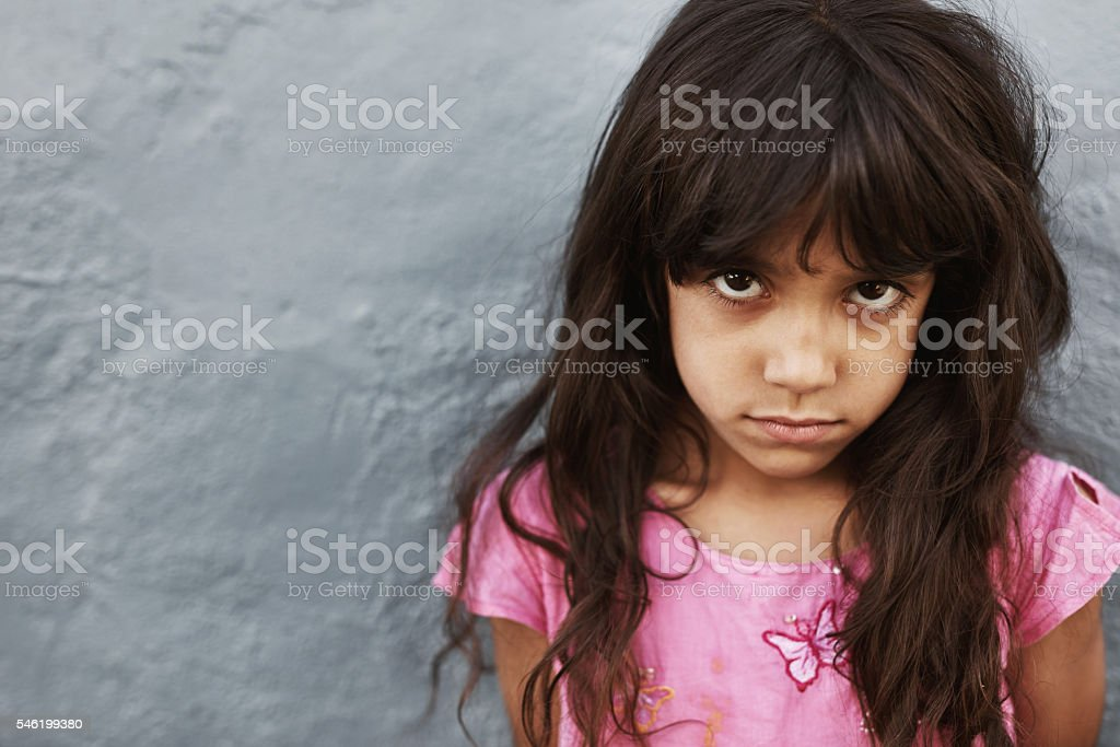 Little girl with serious expression stock photo