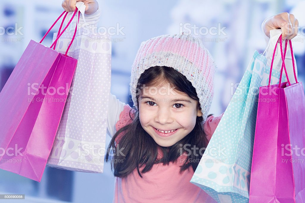 Little girl with shopping bag stock photo