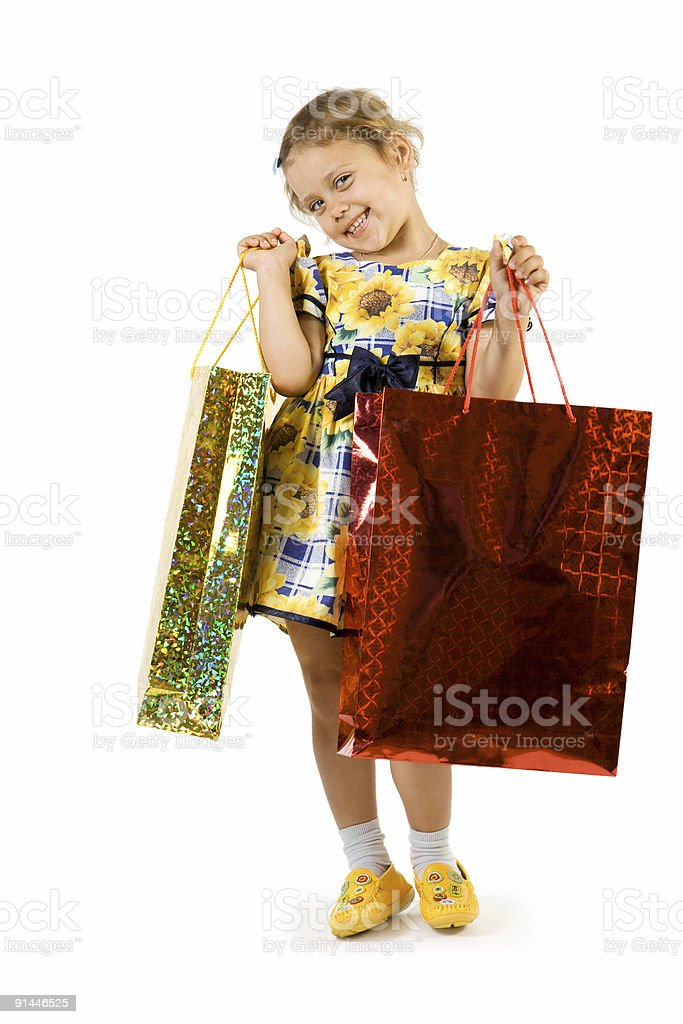 Little girl with shopping bag. stock photo