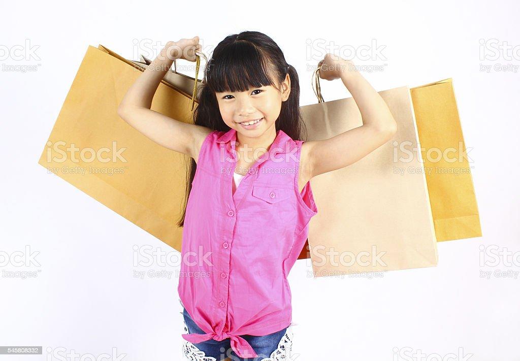 Kleines Mädchen mit Einkaufstasche Lizenzfreies stock-foto