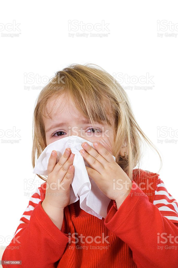 Little girl with sick expression holding up tissue to nose royalty-free stock photo