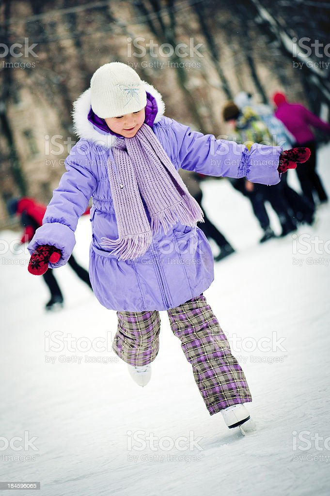 Little girl with skates royalty-free stock photo